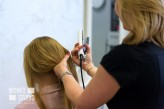 wdnetstudio Professional services in the beauty salon - a young woman with beautiful blond hair has made hairstyles with a curling iron.